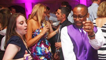 Wedding guests show off their best moves dancing to the music of Retrospect Band