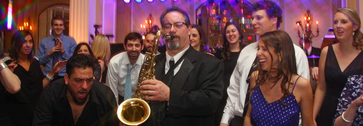 Retrospect Band sax player Don entertains wedding guests on the dance floor