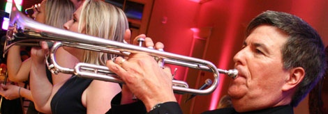 Larry, lead trumpet and Retrospect Band leader, sets the tone at this recent wedding