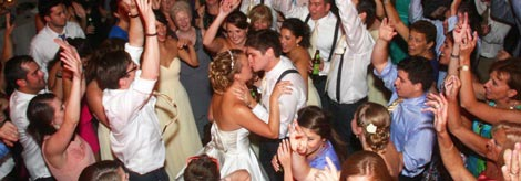 Happy Bride and Groom enjoy the music of Retrospect Band amid a packed dance floor at Meadowlark Gardens in Vienna, VA