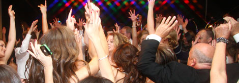 Hands in the air as party goers dance to the music of Retrospect Band