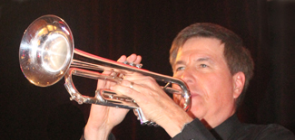 Larry, bandleader and trumpet player with Retrospect Band