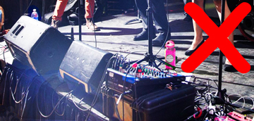 Example of an ugly band setup with wires hanging off the stage