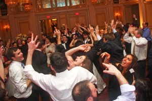 Wedding guests crowding the dance floor at a beautiful ballroom in the Willard hotel as Retrospect Band performs