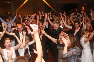 Hands up on a crowded dance floor as Retrospect Band perfoms at a party in DC