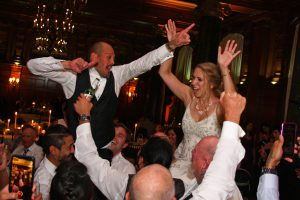 Bride and Groom lifted up to enjoy the music of Retrospect Band at a Willard hotel wedding in DC