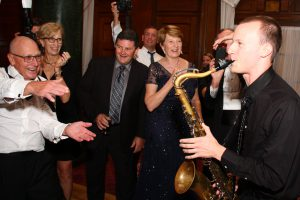 Retrospect Band sax player Charlie serenades guests on the dance floor at a wedding in Washington DC