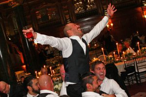 A Groom on his buddies shoulders enjoying the music of Retrospect Band at a recent Willard Hotel wedding