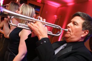 Retrospect Band leader Larry playing trumpet at an Avenel Club wedding in Maryland