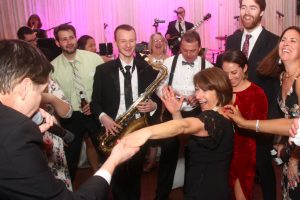 Vocalist Mike and Sax player Charlie mix it up on the dance floor at a recent Retrospect Band wedding at Woodmont Country Club in Maryland