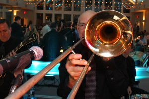 Retrospect Band trombone player Parker with mirror background at a recent Maryland wedding
