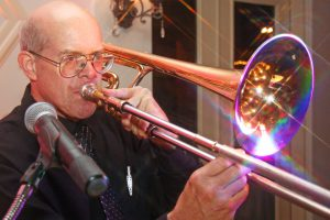 Close up of Retrospect Band trombone player Parker at a recent wedding