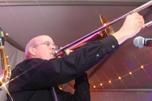Trombone player Parker at a recent Retrospect Band tented wedding