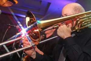 Parker's trombone catches the light at this recent Retrospect Band party in Washington DC