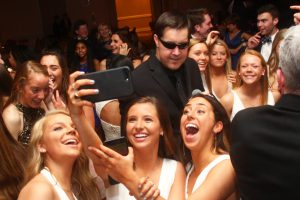 Retrospect Band Vocalist Mike photobombs a group selfie on the dance floor at a recent school party
