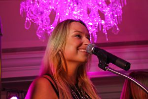 Retrospect Band vocalist Tara performs under the chandelier in the Colonnade Room of the Fairmont Hotel in Washington DC