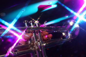 Colorful lights play off silver trumpet at Retrospect Band club showcase