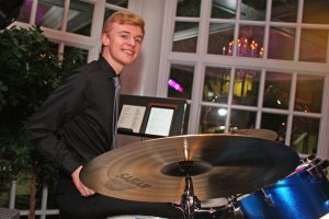 Retrospect Band drummer Dominic playing in the Colonnade Room at a downtown DC wedding