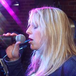 Retrospect Band lead singer Aimee at a recent club showcase