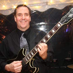 Retrospect Band guitarist Howard at a summer tent wedding on the Eastern Shore of Maryland